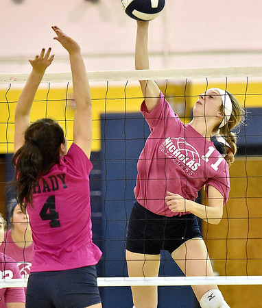 (Brad Davis/The Register-Herald) Nicholas County's Meaghan Willis spikes the ball as Shady Spring defender Rylee Wiseman tries to block Saturday afternoon in Shady Spring.