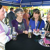 Mary Hill, Trish Meador, Susan Walker and Linda Sumner, chat during the Business After Hours held at City National Bank on Park Ave in Beckley Thursday evening. They held a cookout catered by the Corner Gas & Grill and live music. The event was sponsored by the Beckley-Raleigh County Chamber of Commerce.<br /> (Rick Barbero/The Register-Herald)
