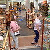 (Brad Davis/The Register-Herald) Shoppers browse the many artistic wares available at Tamarack Friday afternoon.