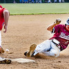 Ryker Brown of Bluefield slides safely into 3rd ahead of the throw caught by Independence's Hunter Schoolcraft.<br /> Tina Laney for Register-Herald
