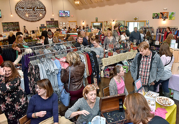 (Brad Davis/The Register-Herald) Patrons and local business owners pack the rooms of Weathered Ground Brewery as the venue hosts a Small Business Sunday event yesterday afternoon. Around 50 local vendors and artisans took part.