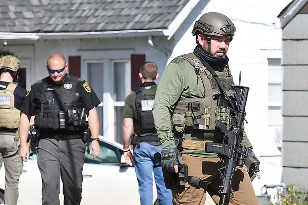 Members of the U.S. Marshall Fugitive Task Force were joined together with Beckley P.D. and Raleigh County Sheriff's Department and arrested a fugitive located in the residence of 219 Westwood Drive in Beckley Thursday morning.<br /> (Rick Barbero/The Register-Herald)