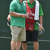 (Brad Davis/The Register-Herald) Marshall Thundering Herd head football coach Doc Holliday chats with his caddie during his Pro-Am round in the Military Tribute at the Greenbrier Wednesday afternoon.