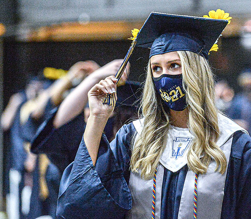 F. Brian Ferguson/Register-Herald  Shady Spring Magna Cum Laude graduate Madison Brown turns her tassel to become an official graduate of the class of 2021 during Friday's Ninety-Seventh Annual Commencement at the Beckley-Raleigh County Convention Center.