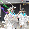 F. Brian Ferguson/Register-Herald  Liberty High School Graduate Alex McKinney, center, sprays streamers on his fellow graduates after Saturday's Liberty High School Commencement at the Beckley-Raleigh County Convention Center.