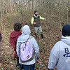 "(Brad Davis/The Register-Herald) Doubling as part trail and tour guide, Active Southern West Virginia Senior Community Captain Levi Moore, upper middle, shows a group of hikers the site of former mine company baseball field as they embark on a light, 2.5 mile journey along the Timber Ridge, Fayetteville and Long Point trail loop as they ""Opt Outside"" instead of partaking in the long lines and hustle of Black Friday shopping Friday afternoon at the Long Point trailhead. Active Southern West Virginia community captains Levi Moore and Hilarie Jones, among others, helped organize the annual hike, which began with the basic idea of encouraging outdoor recreation instead of consumer shopping."