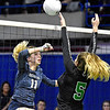 (Brad Davis/The Register-Herald) Nicholas County's Meaghan Willis spikes the ball as Winfield's Jaedyn Ball blocks it during State Volleyball Tournament action Friday afternoon at the Charleston Civic Center.