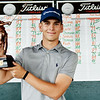 Landon Perry, from Shady Spring, holds the championship trophy for the 2017 BNI at Glade Spring Resort Monday. (Chris Jackson/The Register-Herald)