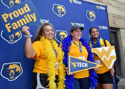 (Brad Davis/The Register-Herald) WVU Tech orientation leaders (from left) Brianna Wallace, Jessica Beck and Sian Smith pose for photos together after a morning of guiding incoming freshman around the campus as students made their return Sunday.