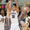 (Brad Davis/The Register-Herald) Woodrow Wilson's Eddie Christian is fouled Cabell Midland's Ty Haynes, left, as he drives to the basket Wednesday night at the Beckley-Raleigh County Convention Center.