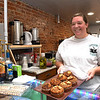 Tabbitha Mains, owner of Coffee On Main on Main Street in Beckley, displays a pan of Pumpkin and Banana Nut Muffins.<br /> (Rick Barbero/The Register-Herald)