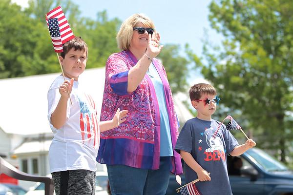 Sanda Sorrels and her grandchildren Quinton Sorrels, 10, and Shane Sorrels, 6, wave to veterans in the Remember the Fallen Ride 2021 in Rainelle Thursday. Jenny Harnish for the Register-Herald