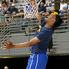 (Brad Davis/The Register-Herald) WVU commit Trey Doomes throws down the dunk that won the event as he competes in the Scott Brown Classic dunk contest Saturday night at the Beckley-Raleigh County Convention Center.
