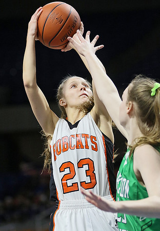 (Brad Davis/The Register-Herald) Summers County's Brittney Justice pulls up for a shot during the Lady Bobcats' opening round State Tournament win over Charleston Catholic Wednesday evening at the Charleston Civic Center.