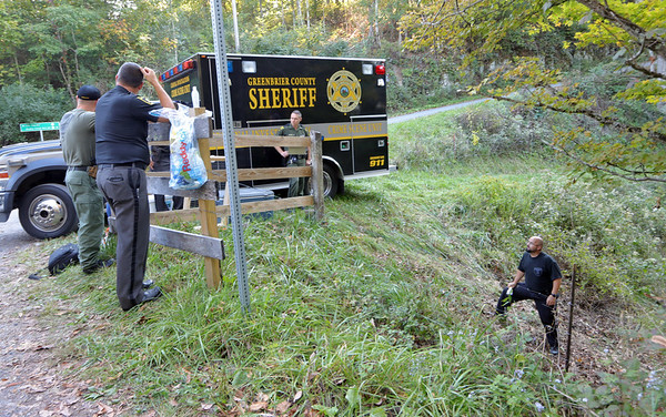 The Greenbrier County Sheriffs Department and West Virginia State Police officers conduct a search for human skeletal remains on the Alderson side of Muddy Creek Mountain Tuesday. A landowner discovered the remains while clearing brush on his property. Jenny Harnish/The Register-Herald