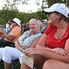 Randy White, left, Nancy White and Leslie White, of Charleston, watch play on the 15th hole during the final round of The Greenbrier Classic.<br /> (Rick Barbero/The Register-Herald)