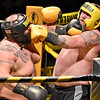 (Brad Davis/The Register-Herald) Heavyweight brawlers Bobby Brown, left, and Jerry Adkins exchange jabs as the two battle during the Original Toughman Contest Friday night at the Beckley-Raleigh County Convention Center. Brown would win the fight.