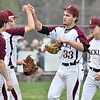 (Brad Davis/The Register-Herald) Woodrow Wilson starting pitcher Hunter Fansler (#33) gets high-fives from teammates after striking out his 17th batter and being lifted for a reliever in the top of the 7th due to pitch count Wednesday evening in Beckley.