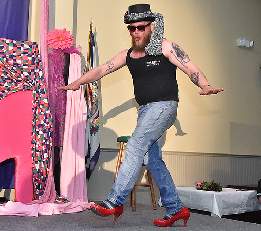 """(Brad Davis/The Register-Herald) Eric Bragg enters the stage during the Hunks in Heels """"Fur"""" Real fundraising event Friday night at the Beckley Moose Lodge."""