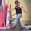 "(Brad Davis/The Register-Herald) Eric Bragg enters the stage during the Hunks in Heels ""Fur"" Real fundraising event Friday night at the Beckley Moose Lodge."
