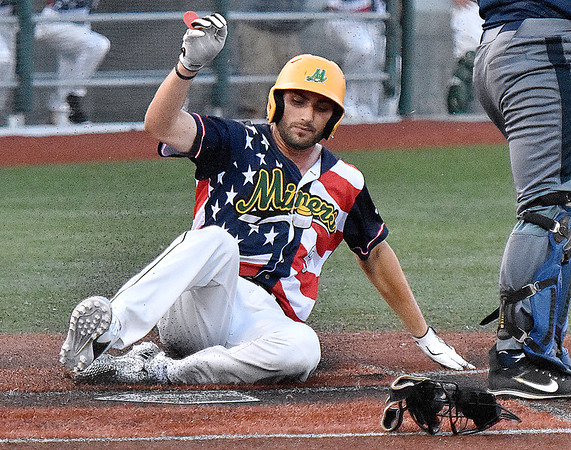 (Brad Davis/The Register-Herald) Miners baserunner Bryson Wallett scores a run off the bat of teammate Jonathan Pasillas against Butler Saturday night at Linda K. Epling Stadium.