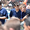 (Brad Davis/The Register-Herald) Young ball players eager to start the season quitely keep their conversation going as they and fellow players from other teams go through the motions of opening day ceremonies Saturday afternoon at Beckley Little League Park.