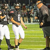 Liberty coach going over the next play Friday night against Wayne.<br /> Tina Laney/for The Register-Herald