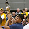 (Brad Davis/The Register-Herald) WVU commit Trey Doomes receives the trophy for winning the Scott Brown Classic slam dunk competition Saturday night at the Beckley-Raleigh County Convention Center.