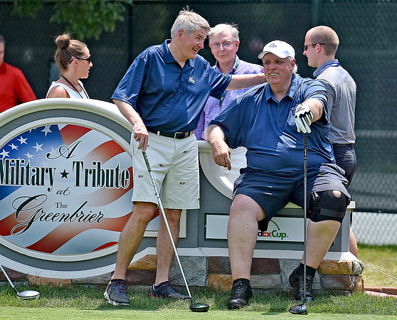 (Brad Davis/The Register-Herald) Governor Jim Justice mingles prior to his Pro-Am round Wednesday afternoon in White Sulphur Springs.
