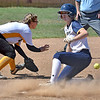 (Brad Davis/The Register-Herald) WVU Tech's Olivia Morey tags up from 2nd base off a flyout to right off the bat of teammate Ashley Daniels and slides into 3rd base before the throw gets to Carlow infielder Ashley Hoak Saturday afternoon at Woodrow Wilson High School.
