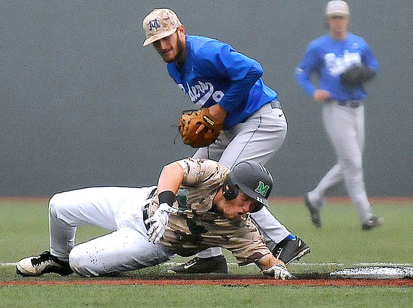 Brad Davis/The Register-Herald Marshall catcher Matt Read overslides second base, but would reach back and get his hand on the bag before Middle Tennessee infielder Dustin Delgado could tag him during a foggy Sunday afternoon at Linda K. Epling Stadium.