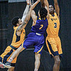 WVU Tech's Juvante' Hayes, left, and Ashton Parker, right, defend against Carlow University's Swade Redman during Friday evening action in Beckley. F. Brian Ferguson