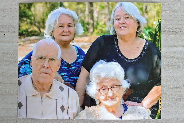 Top row, from left, sisters Krystal Garza and Marsha Ricketts, with their parents Alvin and Betty Norris. All four died of Covid-19. Submitted photo