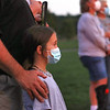 Kayleigh Hayes attends a prayer vigil with her father Thomas Hayes at Greenbrier Valley Medical Center in Fairlea Tuesday.  The vigil was organized by Senator Stephen Baldwin who is also President of the Greenbrier County COVID Task Force, to pray for patients and medical professionals battling the delta variant and to honor those who have lost their lives to the virus. Jenny Harnish/The Register-Herald