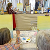 "(Brad Davis/The Register-Herald) Mt. Hope residents Ramona Brown, right, and Dolly Lilly spend a Sunday painting what will eventually be a scene of hot air balloons in an afternoon sky using acrylics on canvas as instructor Lynsi Boyd helps them with tips and tricks during a studio painting session at 110 Marshall in Beckley. The art studio and music venue usually has similar paiting parties scattered throughout the year including on some Sundays. Painting sessions are often themed in a variety of ways designed to help painters build skills in painting certain types of objects or textures, with yesterday's being ""Up, Up an Away"" in reference to the balloons. Similar upcoming painting events will be ""Peaceful River"" on Monday, March 27 at 6:00 p.m. and ""Angel Wings"" Friday, April 7 at 6 p.m. Keep an eye on their facebook page or give them a call at 304-634-8367."