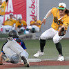 (Brad Davis/The Register-Herald) Miners 3rd baseman John Hagan catches Champion City baserunner Gage Taylor snoozing as he rushes in to grab a quick pickoff throw from catcher Jeffrey Crisan and tag him out Wednesday night at Linda K. Epling Stadium.