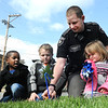 Deputy W.D. Ramey, third from left, helps Carmello Williams, left, Aleck Ramsey and Kelli Smith, pre-school students at Raleigh County Head Start, placed pinwheels in the ground during a program held in front of the Mayors office on South Kanawha Street. Rob Rappold, the Mayor of Beckley, proclaimed April Child Abuse Prevention Month for the City of Beckley.  Just For Kids Child Advocacy Center organized the 5th Annual Plant a Pinwheel for Prevention event on the Mayor's lawn.  Over 30 children from the Raleigh County Head Start Center came and helped the Mayor and two Deputies from the Sheriff's Dept. plant pinwheels.<br /> (Rick Barbero/The Register-Herald)