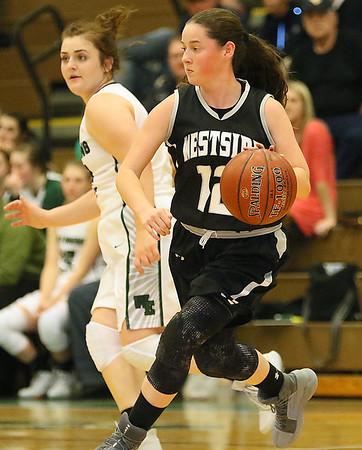 (Brad Davis/The Register-Herald) Westside's Makayla Morgan hustles up the court against Wyoming East Thursday night in New Richmond.