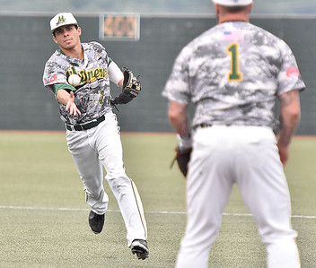 (Brad Davis/The Register-Herald) Miners 2nd baseman Fernando Ortiz tosses over to first baseman Kendrick Epling to record an out during the first game of a double header against Champion City Wednesday at Linda K. Epling Stadium.