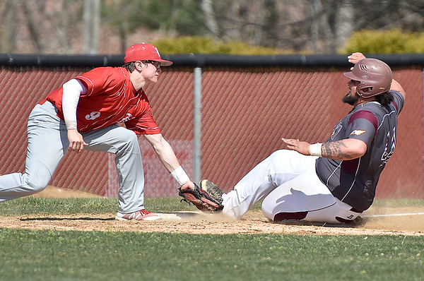 (Brad Davis/The Register-Herald) Woodrow Wilson's Bradley Pack advances on a passed ball and slides into third base before Hurricane 3rd baseman Logan McLure can get the tag on him Saturday afternoon in Beckley.