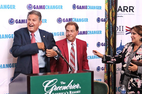 Senator Joe Manchin and Nick Saban attend a press conference about the West Virginia Game Changers at The Greenbrier Resort Wednesday. Game Changers is an initiative designed to educate and empower West Virginia youth and funding will be used to develop substance misuse prevention education programs.  Jenny Harnish for the Register-Herald