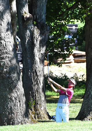 Bubba Watson hits his second shot on the par 4, 16th between trees during A Military Tribute at The Greenbrier golf tournament held at The Greenbrier Resort in White Sulphur Springs.<br /> (Rick Barbero/The Register-Herald)