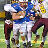 (Brad Davis/The Register-Herald) Midland Trail's Colton Yoder rumbles past Sherman defenders Dustin Harvey, left, and Tommy Harper for one of his key carries of the second half Friday night in Fairlea.