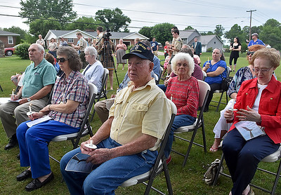 (Brad Davis/The Register-Herald) Area residents, war veterans and relatives of the fallen share a solemn moment of silence and reflection as they remember those who've made the ultimate sacrifice during candlelight vigil at Fayetteville's Huse Memorial Park Sunday evening.