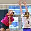 (Brad Davis/The Register-Herald) Shady Spring's Madison Shepherd spikes the ball as James Monroe's Morgan Boroski steps up to block it Saturday afternoon in Shady Spring.