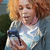 Carly Ward shares her experiences with hair discrimination with Council members on a remote call from the lawn of City Hall Tuesday.  Jenny Harnish for the Register-Herald