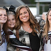 Woodrow Wilson head cheerleading coach, Makayla Martin, poses with some of her cheering team during game againt Morgantown held at Woodrow Wilson High School.<br /> (Rick Barbero/The Register-Herald)
