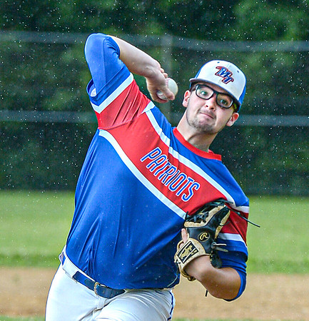F. Brian Ferguson/Register-Herald  Midland Trail pitcher Bo Persinger delievers in the rain against Greenbrier West during Monday evening action in Hico.