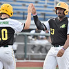 (Brad Davis/The Register-Herald) Miners players Muddux Houghton, left, and Mason Washington high-five at the plate after scoring off teammate Dylan Shockley's bloop single to right Wednesday night at Linda K. Epling Stadium.