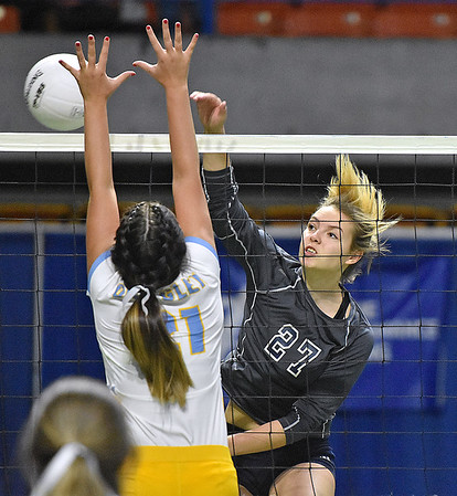 (Brad Davis/The Register-Herald) Independence's Destiny Blankenship spikes the ball as Oak Glen's Jaedyn Hissam tries to block it during State Volleyball Tournament action Friday morning at the Charleston Civic Center.